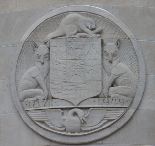 crest with Art Deco animals