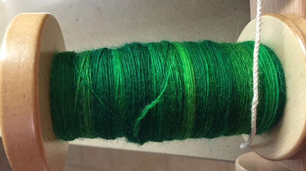 BFL in green from Fiber Optic Yarns - first bobbin