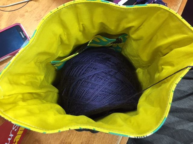 Echinacea bag with a skein of Wollmeise Lace